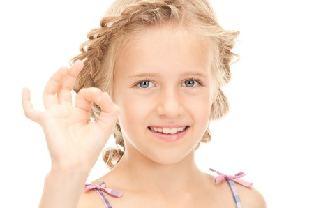 bright picture of lovely girl showing ok sign Stock Photo - 7956845
