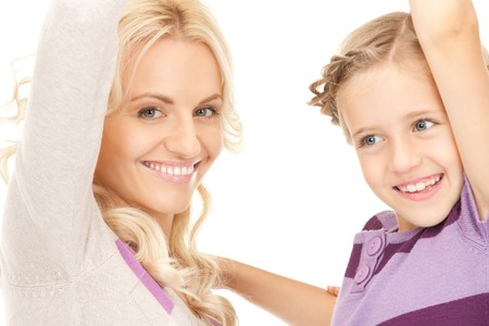 bright picture of happy mother and child (focus on woman) Stock Photo - 7956852