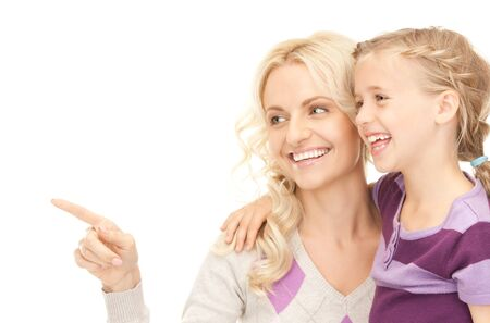 bright picture of happy mother and child (focus on woman) Stock Photo - 7956903