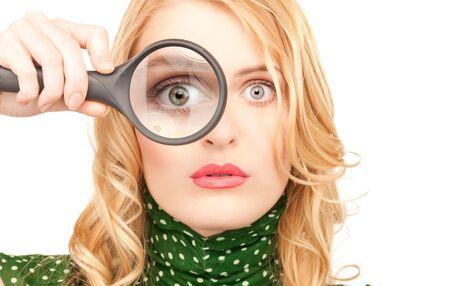 picture of woman with magnifying glass (focus on hand) photo