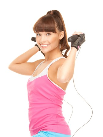 lovely fitness instructor with jump rope over white Stock Photo - 8015894