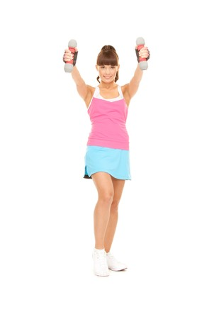 lovely fitness instructor with dumbbells over white photo