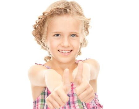 bright picture of lovely girl with thumbs up  photo