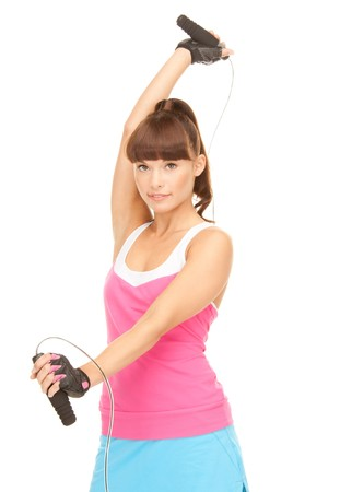 lovely fitness instructor with jump rope over white Stock Photo - 8016163