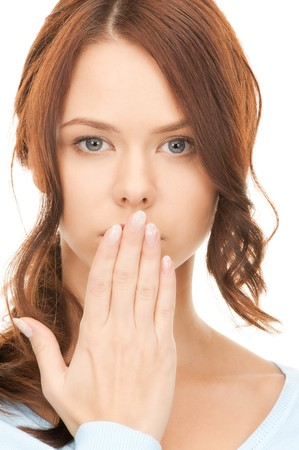 bright picture of pretty woman with hand over mouth Stock Photo - 8016197