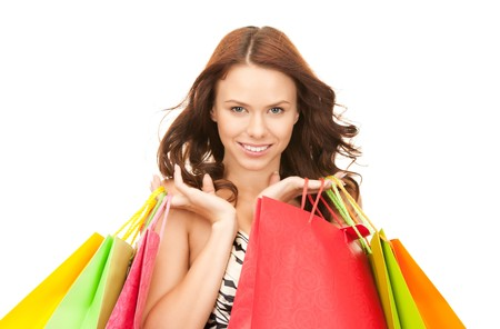 lovely woman with shopping bags over white Stock Photo - 8016172