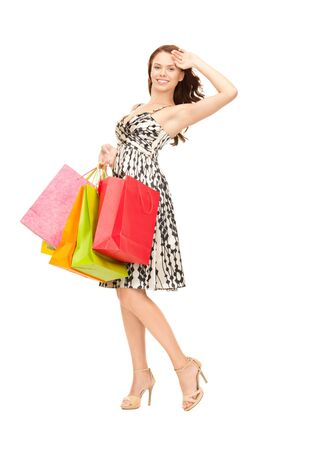 lovely woman with shopping bags over white Stock Photo - 8016166