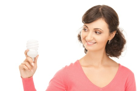 bright picture of woman holding energy saving bulb Stock Photo - 8016246