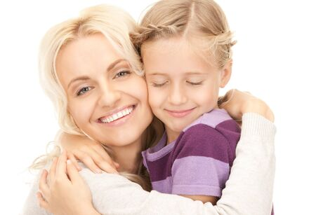 bright picture of happy mother and child (focus on woman) Stock Photo - 8072140