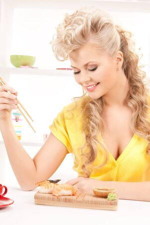 bright picture of lovely woman eating sushi photo