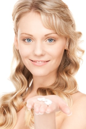 picture of young woman with pills over white photo