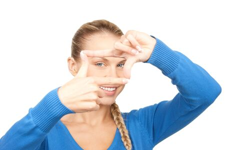 picture of lovely woman creating a frame with fingers photo