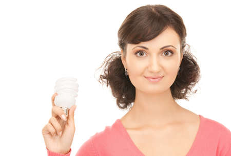 bright picture of woman holding energy saving bulb Stock Photo - 8072141
