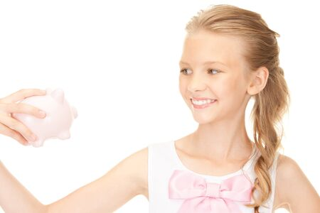picture of lovely teenage girl with piggy bank photo