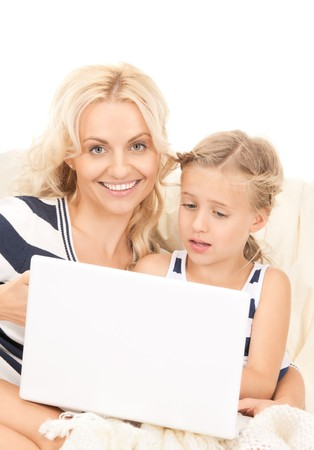 bright picture of happy mother and child with laptop computer  photo