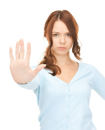 bright picture of young woman making stop gesture Stock Photo - 8072851