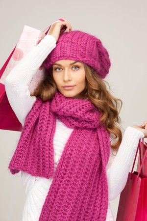 lovely woman with shopping bags over white Stock Photo - 8073027