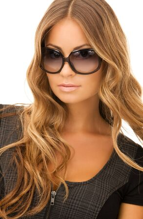portrait of lovely woman in shades over white photo