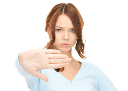 bright picture of young woman making stop gesture Stock Photo - 8072925