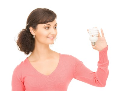 bright picture of woman holding energy saving bulb photo