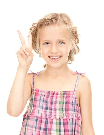 bright picture of lovely girl showing victory sign  photo