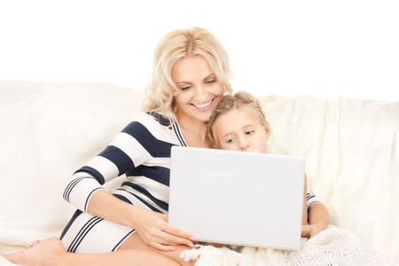 bright picture of happy mother and child with laptop computer Stock Photo - 8072931