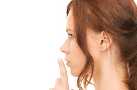 bright picture of young woman with finger on lips Stock Photo - 8072960