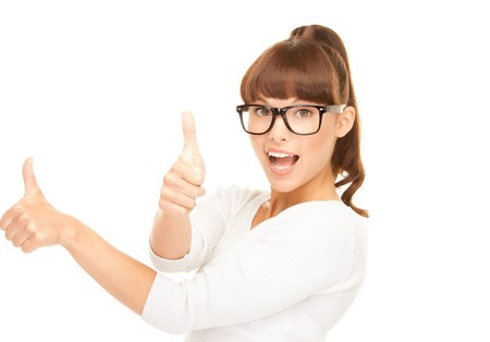 nice looking: bright picture of lovely teenage girl with thumbs up Stock Photo