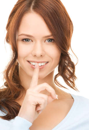 bright picture of young woman with finger on lips Stock Photo - 8073085