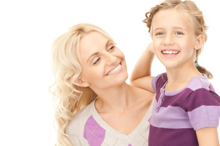 bright picture of happy mother and child (focus on woman) Stock Photo - 8136020
