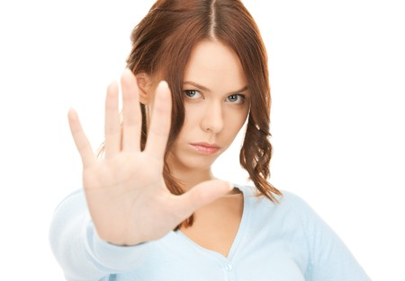 veto: bright picture of young woman making stop gesture