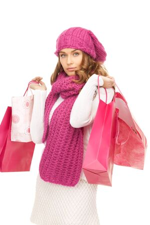 lovely woman with shopping bags over white Stock Photo - 8136330