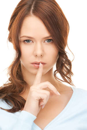 bright picture of young woman with finger on lips Stock Photo - 8136371