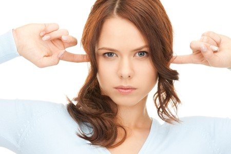 insult: picture of woman with fingers in ears Stock Photo