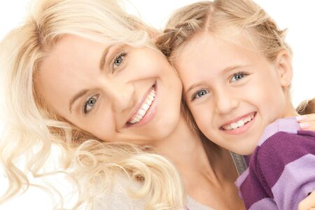 bright picture of happy mother and child (focus on girl) Stock Photo - 8136444