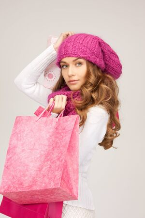 lovely woman with shopping bags over white Stock Photo - 8133884