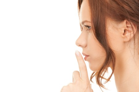 bright picture of young woman with finger on lips Stock Photo - 8136618
