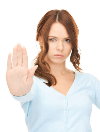 no person: bright picture of young woman making stop gesture