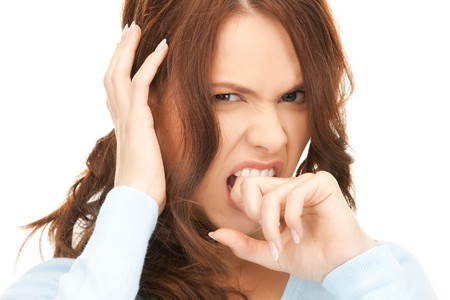 bright picture of unhappy woman over white Stock Photo - 8136982