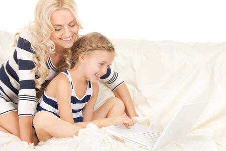 preteen girls: bright picture of happy mother and child with laptop computer (focus on girl) Stock Photo