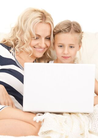 bright picture of happy mother and child with laptop computer Stock Photo - 8155464