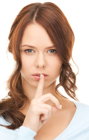 bright picture of young woman with finger on lips Stock Photo - 8214511