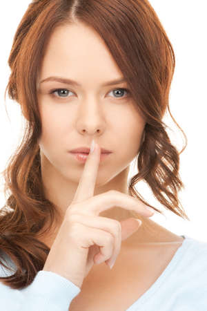 bright picture of young woman with finger on lips Stock Photo - 8214928