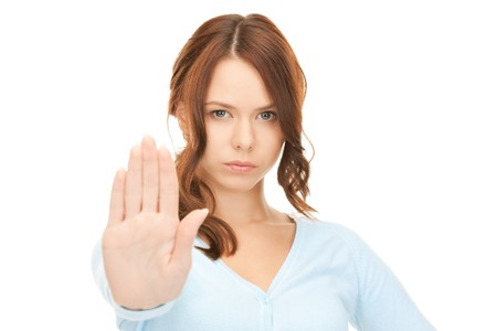 bright picture of young woman making stop gesture Stock Photo - 8214986