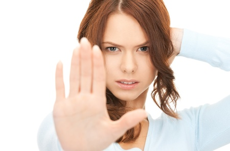 bright picture of young woman making stop gesture Stock Photo - 8277024