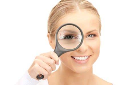 picture of woman with magnifying glass over white Stock Photo - 8277035