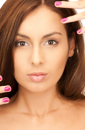 bright picture of lovely woman with polished nails over white Stock Photo - 8277120