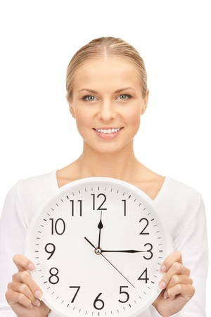 12 oclock: picture of woman holding big clock over white