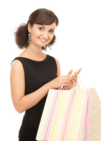lovely woman with shopping bags over white Stock Photo - 8277257