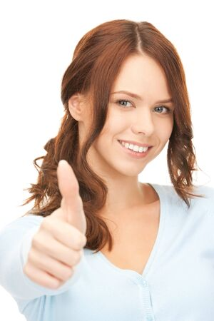 bright picture of lovely teenage girl with thumbs up Stock Photo - 8324884